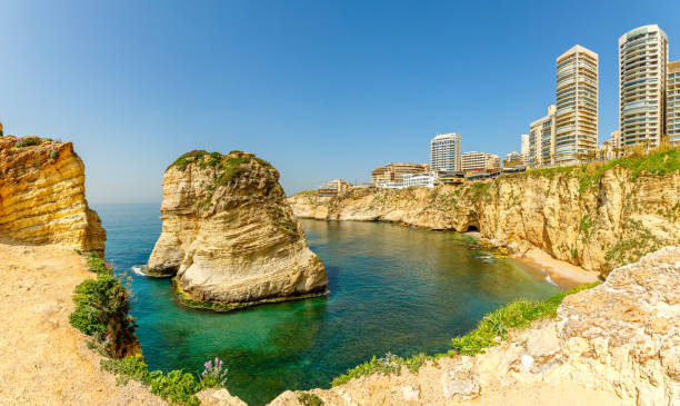 raouche or pigeons rocks panorama with sea and city center in the background, beirut, lebanon - beirut стоковые фото и изображения