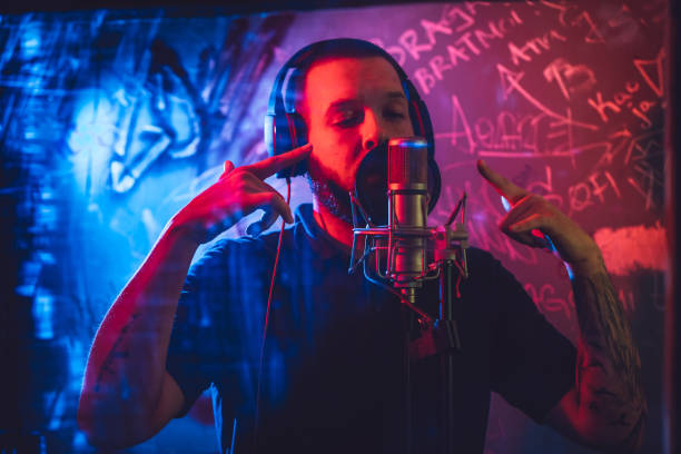 Rap musician in studio stock photo