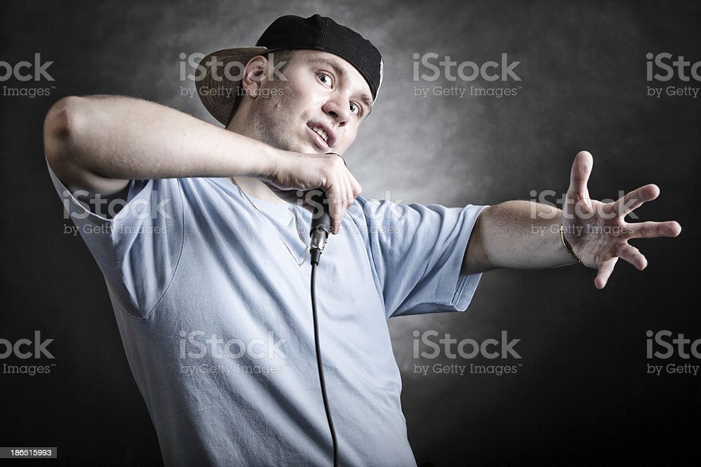Rap singer man with microphone cool hand gesture royalty-free stock photo