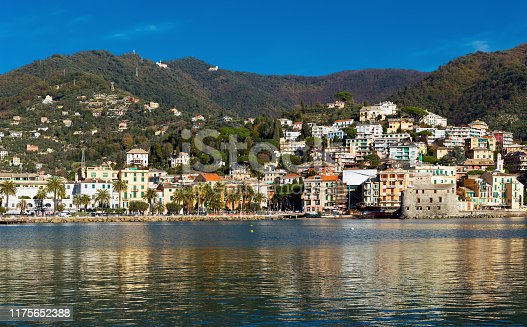 View of small scenic town of Rapallo with castle on Ligurian Sea coast of Italy