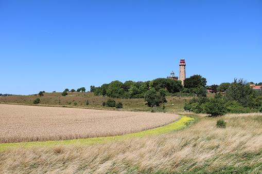 Rape field and New lighthouse at Cape Arkona on Island Rügen, Germany. Baltic Sea