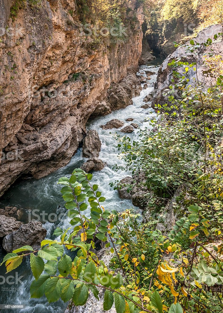 Rapid mountain river washed in lime line with bizarre twists. stock photo