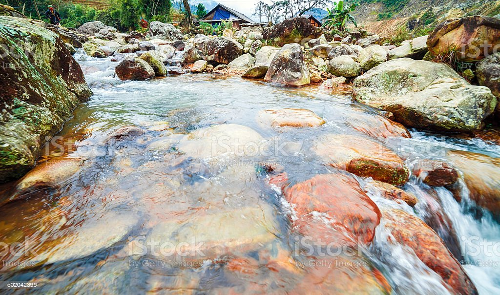 Rapid River with large stone boulders stock photo