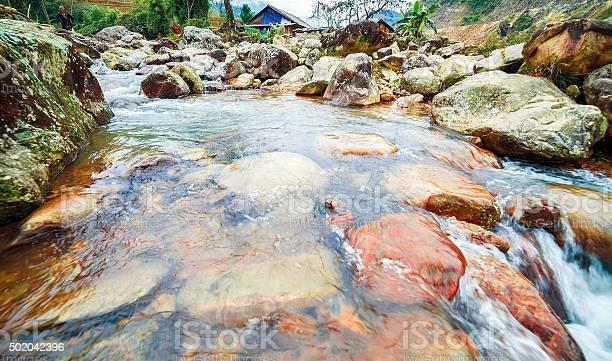 Photo of Rapid River with large stone boulders