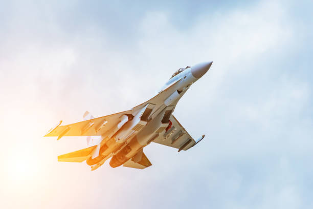 Rapidly taking off combat fighter in the air. Rapidly taking off combat fighter in the air fighter plane stock pictures, royalty-free photos & images