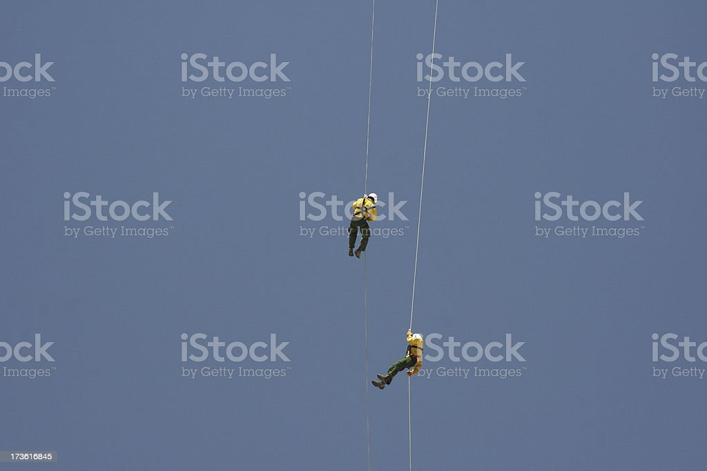 Rappelling Smoke Jumpers stock photo