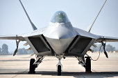 'An F-22 Raptor stealth fighter parked on the ramp at Miramar MCAS, San Diego, California.'
