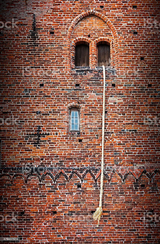 Rapunzel story, old tower with a long hair plait stock photo