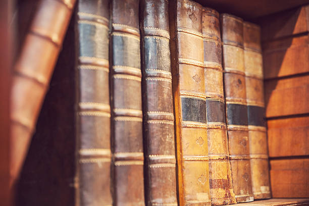 Rare and old First edition books on a bookshelf