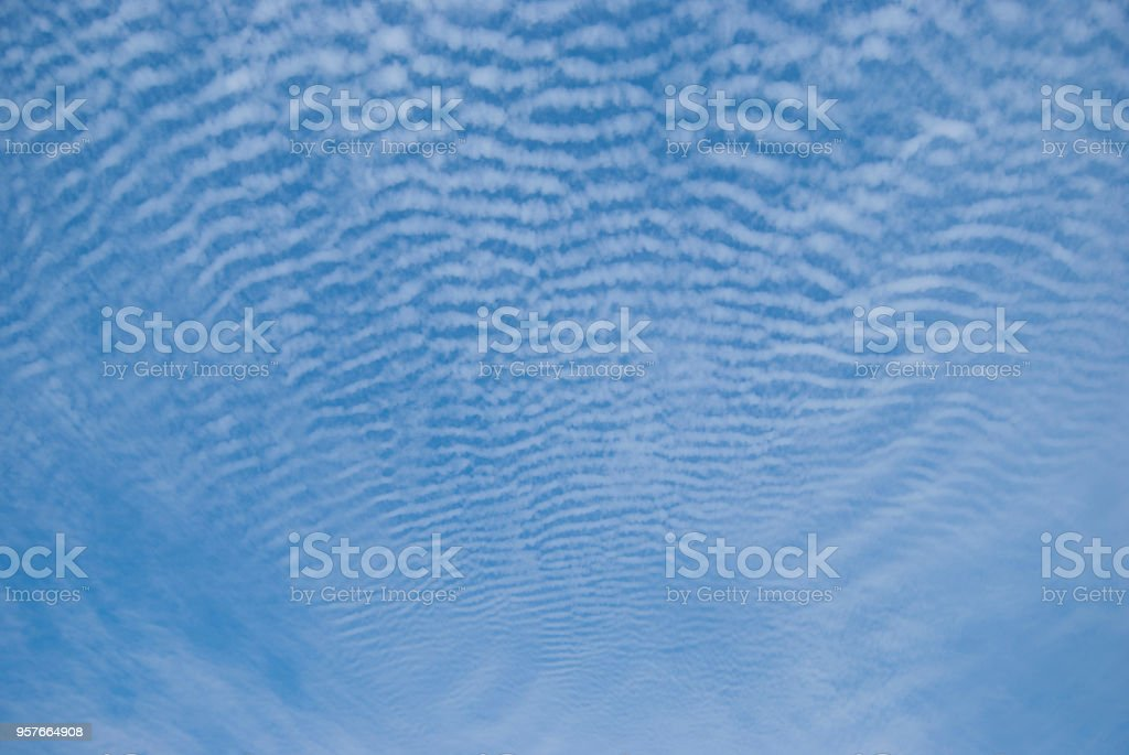 Rare, striped cumulus clouds in the sky stock photo