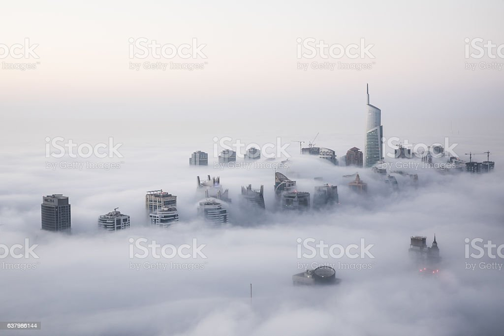 Rare winter morning fog blanketing Dubai skyscrapers. stock photo