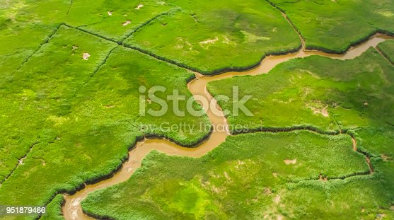 Aerial shot of the Raritan River flowing through the agricultural land. Shot in USA.
