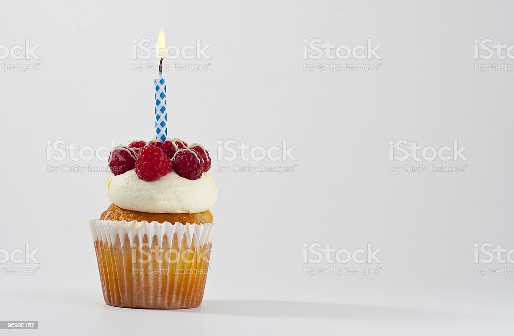 Rasberry cupcake with candle royalty-free stock photo