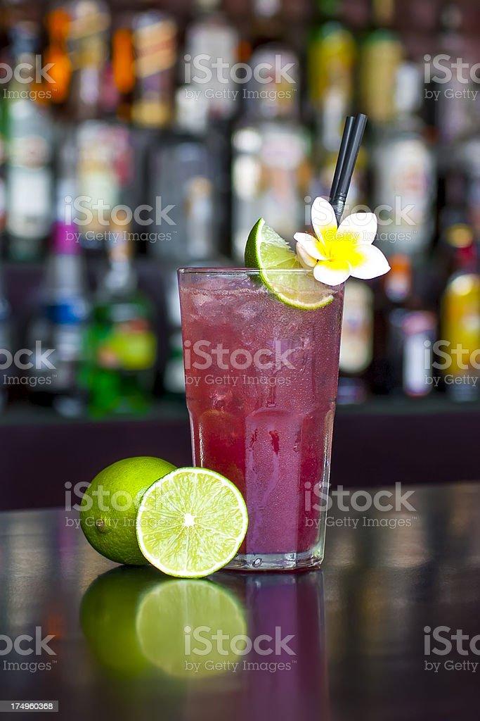 Rasberry Long Island Iced Tea cocktail on the bar table stock photo