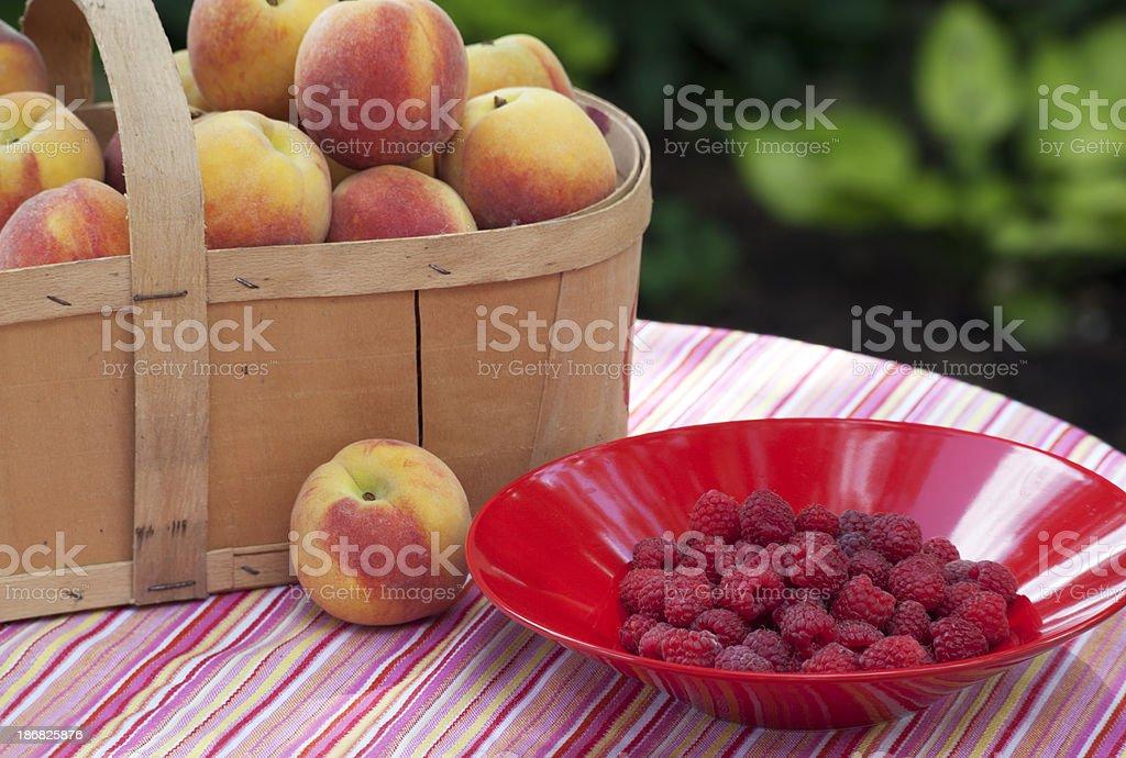 Raspberries and Peaches stock photo
