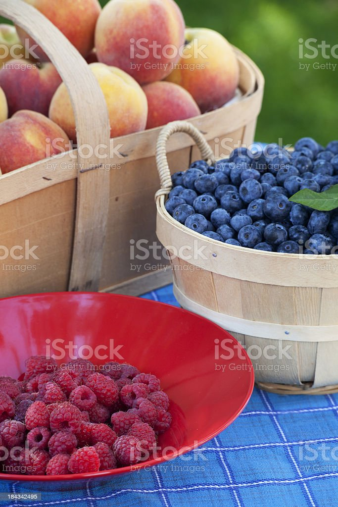 Raspberries, Blueberries and Peaches stock photo