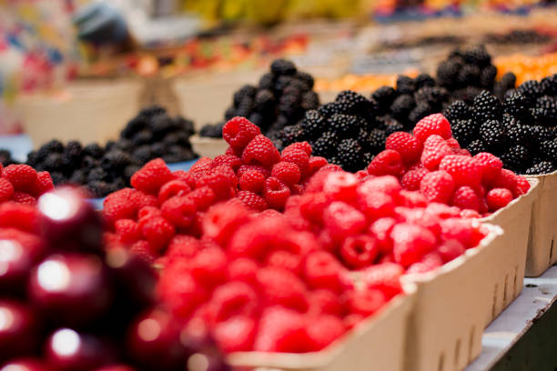 raspberries market display - berry stock photos and pictures