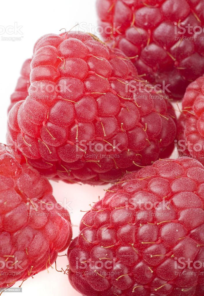 Raspberries on a white background royalty-free stock photo