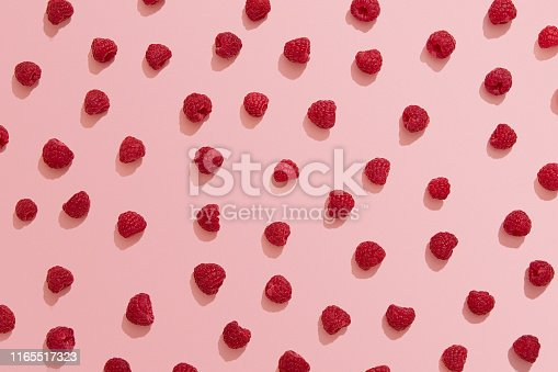 Raspberry, pink background, flat lay, directly above