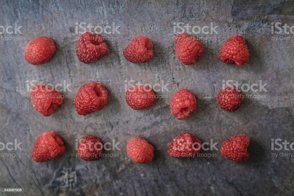 Raspberries on the dark stone background Lizenzfreies stock-foto