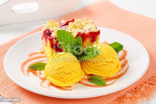 Piece of raspberry crumb cake with ice cream