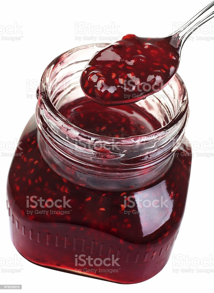 Raspberry confiture in a jar on a white background royalty-free stock photo