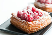 close up of fresh raspberry danish breads