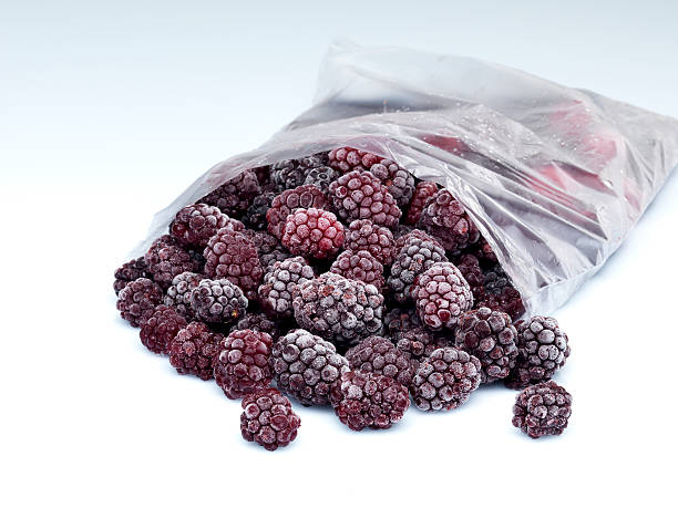 raspberry in the fridge bag - frozen berries stock photos and pictures