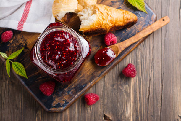 Raspberry jam and fresh raspberry stock photo