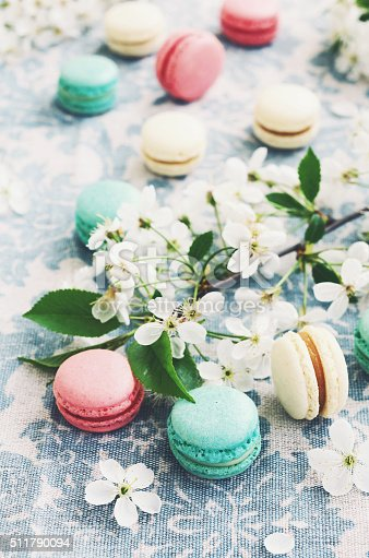 istock Raspberry, minty and vanilla macaroons decorated with flowers 511790094