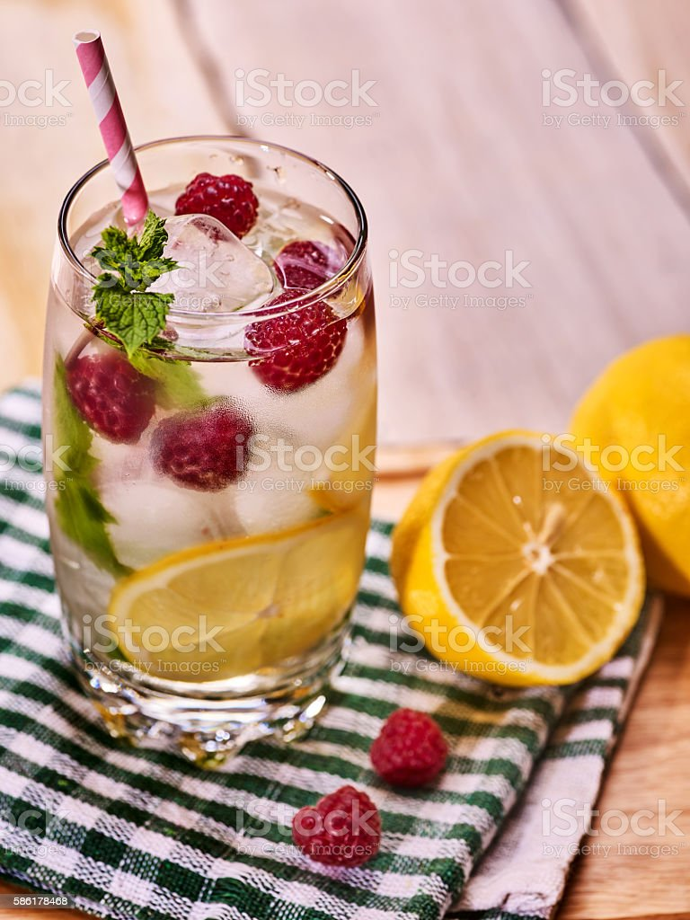 Raspberry mojito with cubes ice glass. stock photo