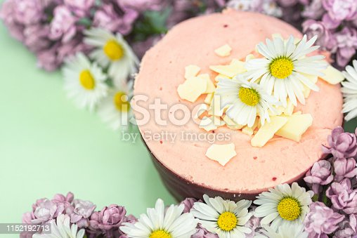 istock Raspberry mousse decorated with flowers 1152192713