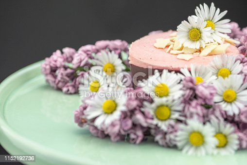istock Raspberry mousse decorated with flowers 1152192736