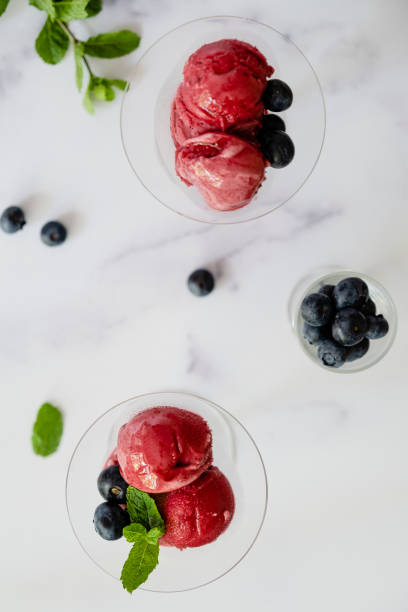 Raspberry Sorbet Garnished with Blueberries and Mint stock photo