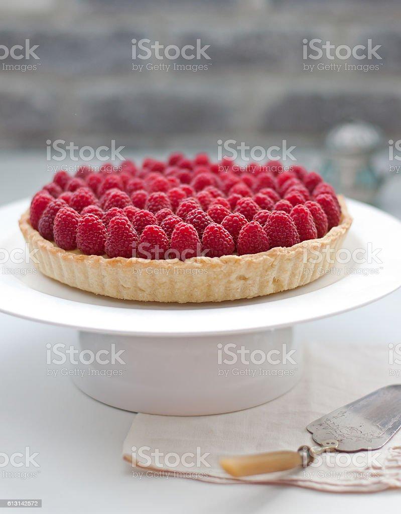 Raspberry tart on a white plate Selective focus stock photo