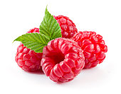 Raspberry with leaves isolated on white background.