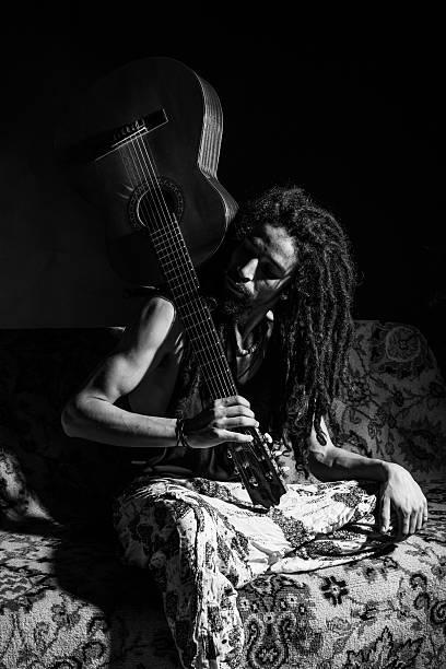 rastafarian with guitar - reggae stok fotoğraflar ve resimler