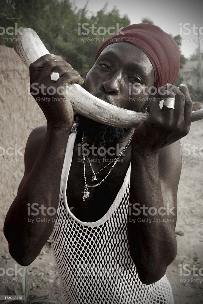 rastafarian with horn stock photo