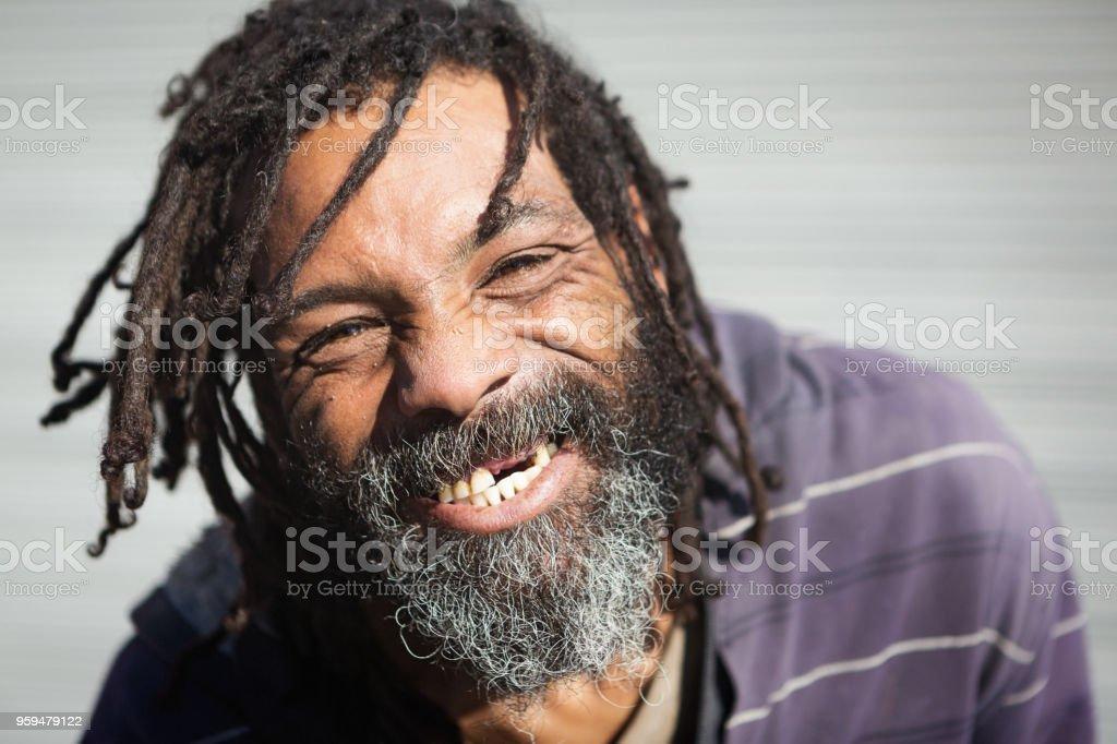 Rastafarian with missing teeth laughs stock photo