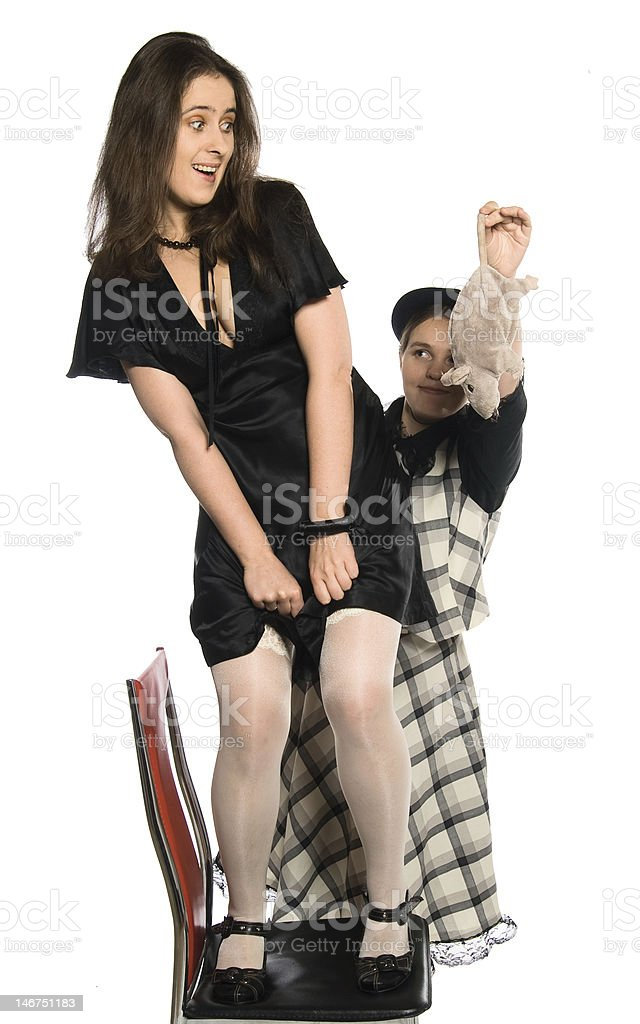Rat! (Girl frighten another with toy) stock photo