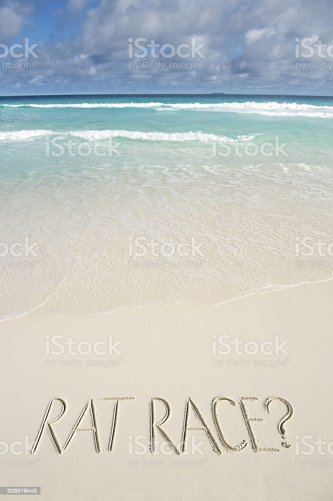 Rat Race Message on Bright Tropical Beach stock photo