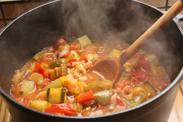 Cтоковое фото Ratatouille being cooked in a cast iron casserole  French cooking