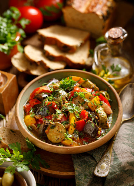 ratatouille, vegetarian stew made of zucchini, eggplants, peppers, onions, garlic and tomatoes with addition of aromatic herbs. - braised stock pictures, royalty-free photos & images