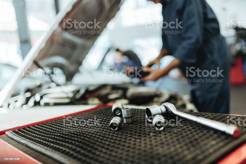 Ratchet spanner and sockets in car workshop stock photo