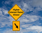 "A sign that says ""Higher Interest Rates Ahead."""