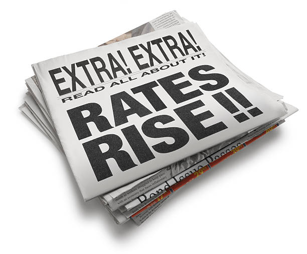 Rates Rise A newspaper with headline