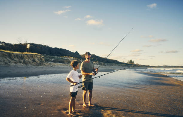 rather teach them instead of just giving - fishing stock pictures, royalty-free photos & images