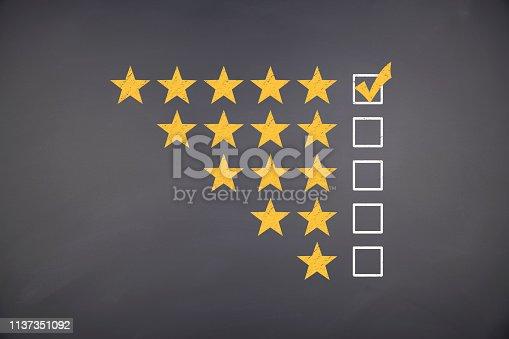 istock Rating Five Golden Stars on blackboard 1137351092