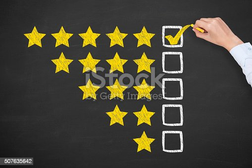 istock Rating Five Golden Stars on Blackboard 507635642