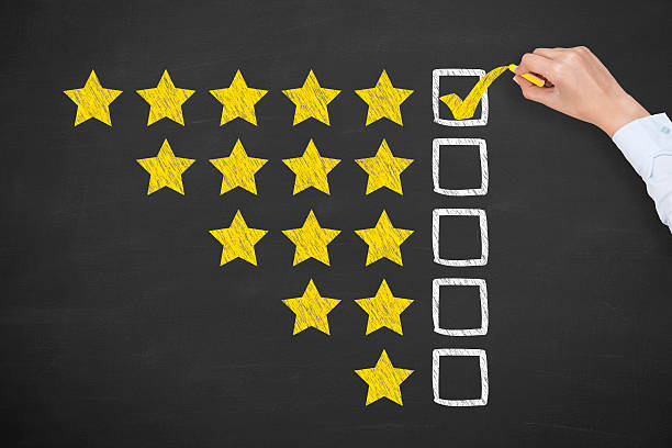 rating five golden stars on blackboard - testimonial stock photos and pictures